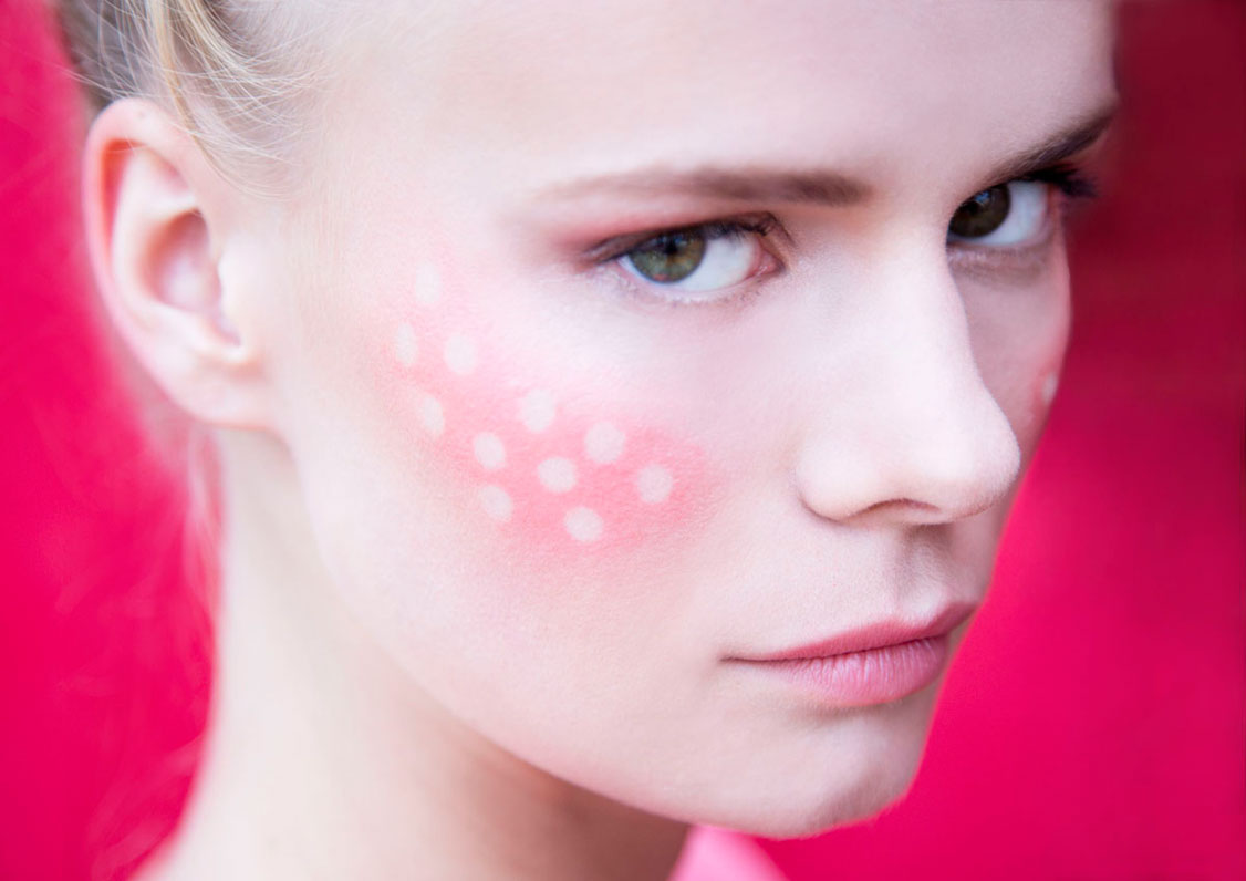 model in alternative make-up with dots