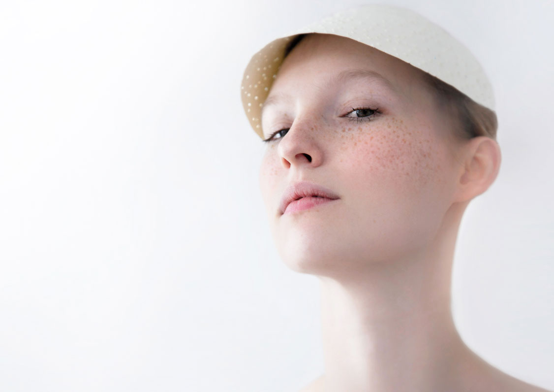Beautiful, freckled girl in cap by Magdalena Czajka