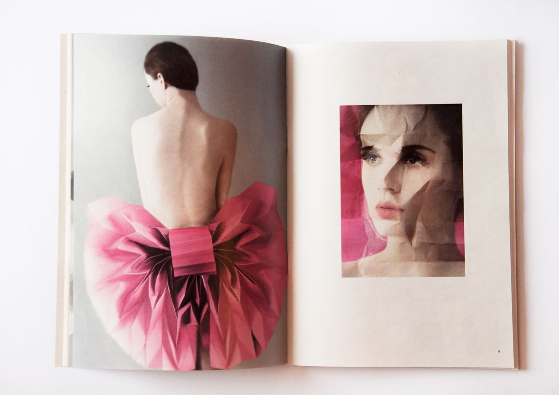 Kinga with sexy back and huge paper bow in magazine about paper