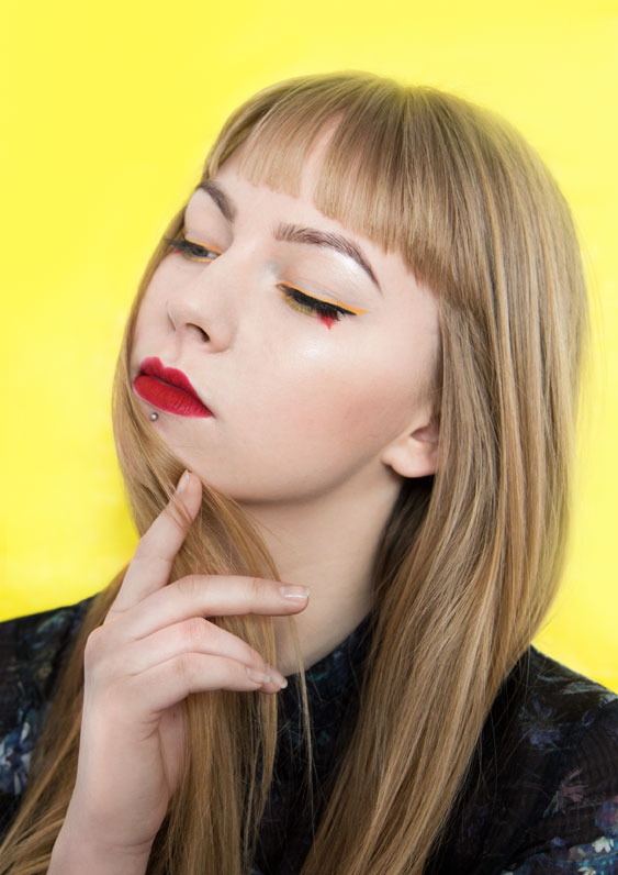 Roksana in yellow and red make-up in beauty photography