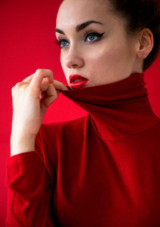Sexy, stunning model in turtle-neck sweater and retro make-up